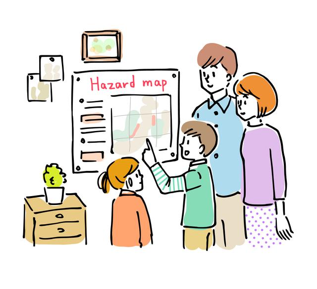 ハザードマップを確認する家族